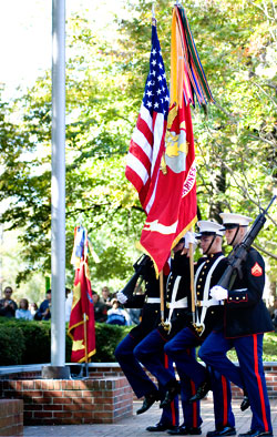 A Marine Corps color guard participates in a ceremony.