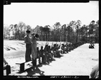Men of the 51st Defense Battalion, the first combat unit trained at Montford Point, waiting to be called to rifle practice on the rifle range, March 1943.