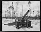 Men of the 51st Defense Battalion also trained with large field pieces. In this photo they operate a 155 millimeter howitzer, March 1943.
