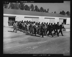Marching new recruits to the Quartermasters for uniforms, March 1943.
