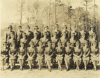 Women Marines basic training class, 1944 - Group photo of a Women Marines basic training class at Camp Lejeune, North Carolina, in early 1944. All of the women wear the Women Marines winter service uniform and winter service hat. Marian Gold Krugman Papers Collection (WV0354.6.002), Betty H. Carter Women Veterans Historical Project, University of North Carolina at Greensboro, NC